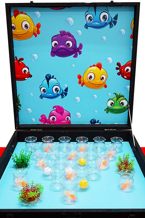 Toss the balls into the glass cups, avoid the fish!