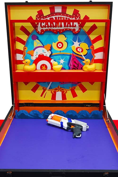 PLAYER IS GIVEN 6 NERF GUN SHOTS. SHOOT DOWN 2 DUCKLING TO WIN.